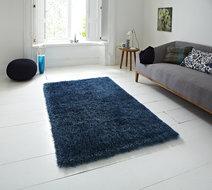 blauw hoogpolig vloerkleed